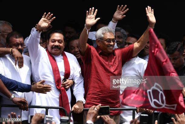 Sri Lankan presidential candidate Gotabaya Rajapaksa and his brother, former president Mahinda Rajapaksa acknowledge their supporters after...