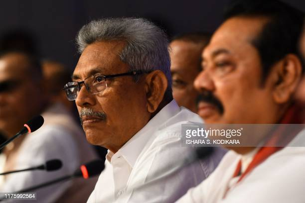 Sri Lankan presidential candidate Gotabhaya Rajapaksa and opposition leader and former president Mahinda Rajapaksa look on during a press conference...