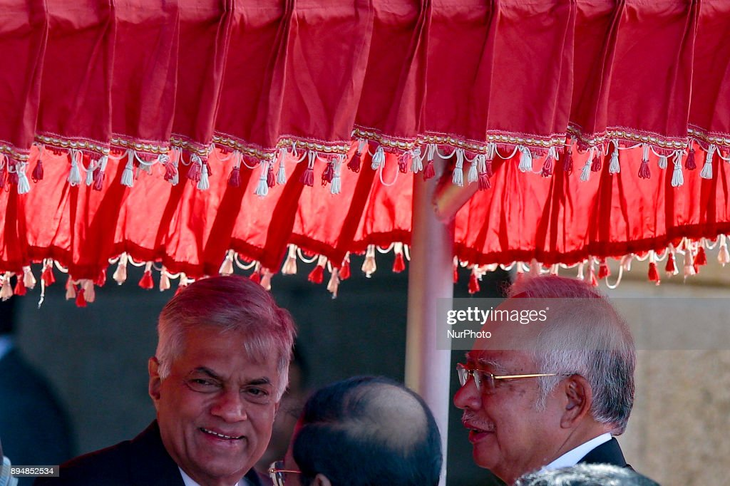 Sri Lankan Prime Minister Ranil Wickramasinghe (L) and Malaysian Prime Minister Najib Razak are seen in a discussion after their meeting in Colombo, Sri Lanka, Monday,18, December 2017. Razak will leave to Maldives on 19 after a three day official visit to Sri Lanka.