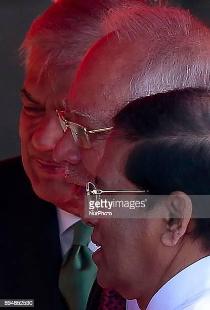 Sri Lankan Prime Minister Ranil Wickramasinghe Malaysian Prime Minister Najib Razak and Sri Lankan President Maithripala Sirisena are seen in a...