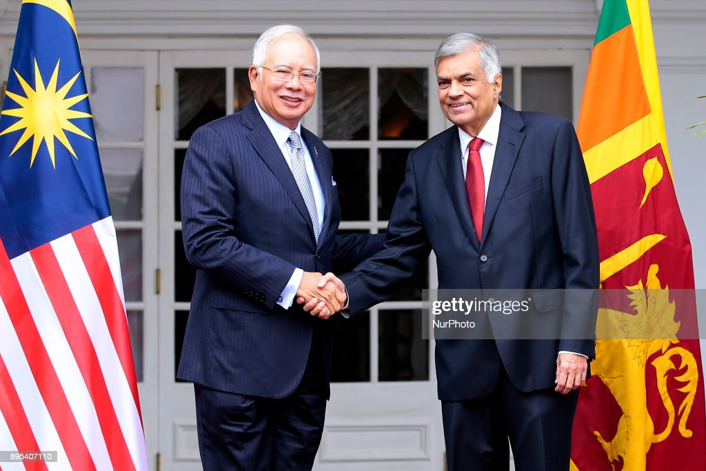 Sri Lankan Prime Minister Ranil Wickramasinghe (R) shakes hands with Malaysian Prime Minister Najib Razak at Prime Minister's Office, Colombo, Sri Lanka, Tuesday,19, December 2017. Sri Lanka and Malaysia are celebrating the 60th anniversary of the establishment of diplomatic relations. Razak will leave to Maldives on 19 after a three day official visit to Sri Lanka.