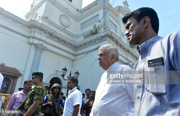 Sri Lankan Prime Minister Ranil Wickremasinghe arrives to visit the site of a bomb attack at St Anthony's Shrine in Kochchikade in Colombo on April...