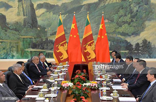 Sri Lankan Prime Minister, Ranil Wickremesinghe and Chinese President, Xi Jinping attend a meeting at the Great Hall of the People on April 8, 2016...