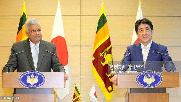 Sri Lankan Prime Minister Ranil Wickremesinghe and his Japanese Prime Minister Shinzo Abe attend a joint press conferene following their talks at...