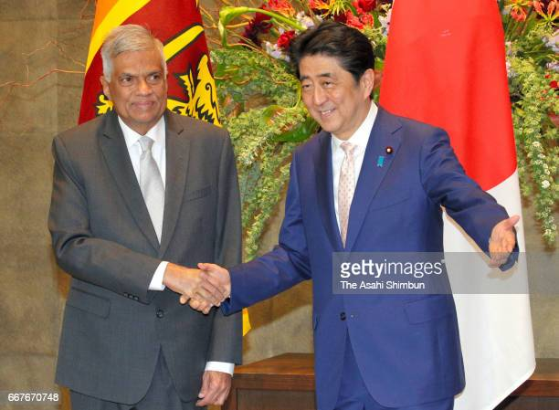 Sri Lankan Prime Minister Ranil Wickremesinghe and his Japanese Prime Minister Shinzo Abe shake hands at Abe's official residence on April 12 2017 in...