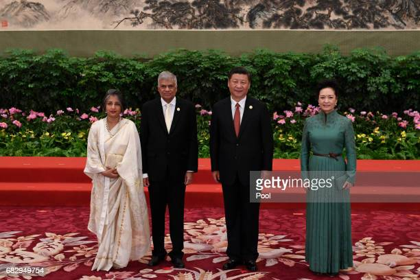 Sri Lankan Prime Minister Ranil Wickremesinghe and his wife Maitree Wickremesinghe pose with Chinese President Xi Jinping and his wife Peng Liyuan...