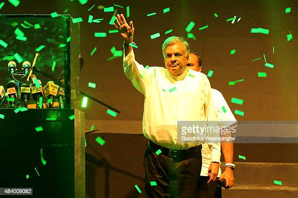 Sri Lankan Prime Minister Ranil Wickremesinghe of the United National Party waves to voters during his party's political campaign rally on August 14,...