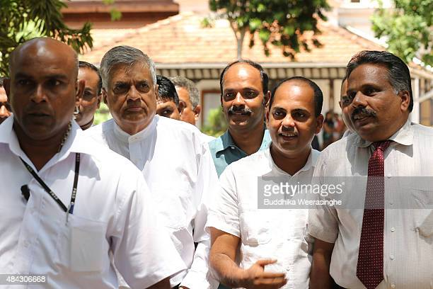 Sri Lankan Prime Minister Ranil Wickremesinghe of the United National Party leaves after after casting his vote in the General election on August 17...