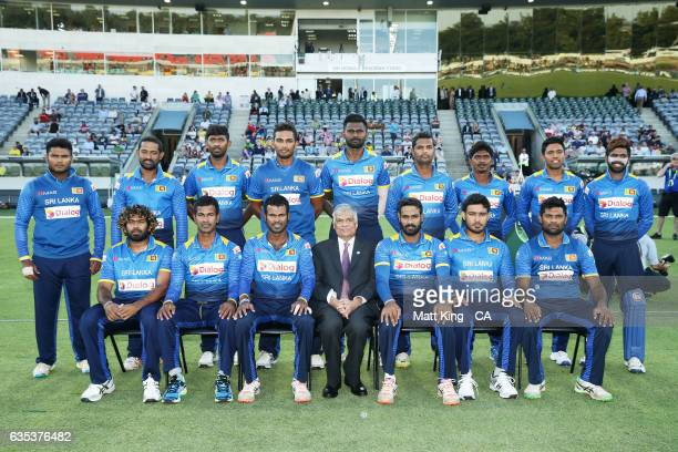 Sri Lankan Prime Minister Ranil Wickremesinghe poses with the Sri Lankan team prior to the T20 warm up match between the Australian PM's XI and Sri...
