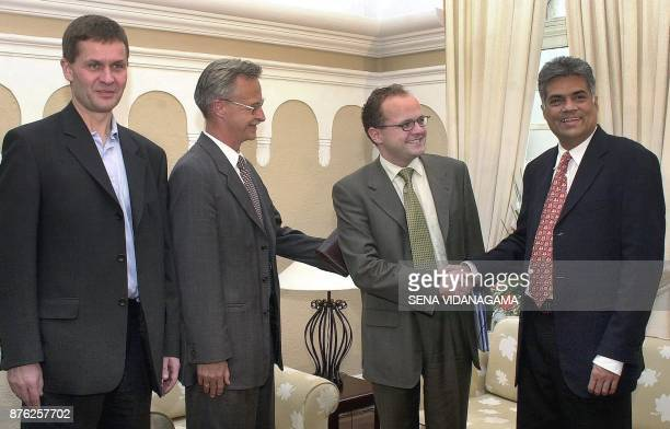 Sri Lankan Prime Minister Ranil Wickremesinghe shakes hands with Norway's Deputy Foreign Minister Vidar Helgesonis in Colombo 10 January 2002 ahead...
