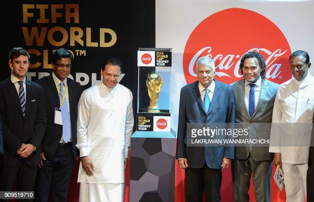 Sri Lankan Prime Minister Ranil Wickremesinghe Sports Minister Dayasiri Jayasekara and French football player Christian Karembeu a 1998 FIFA World...