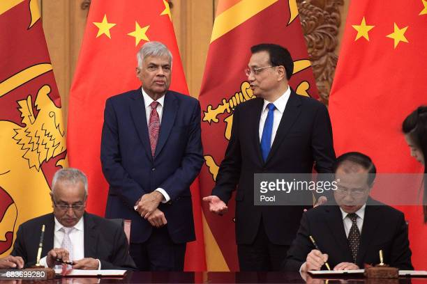 Sri Lankan Prime Minister Ranil Wickremesinghe talks with Chinese Premier Li Keqiang during a signing ceremony at the Great Halll of the People in...
