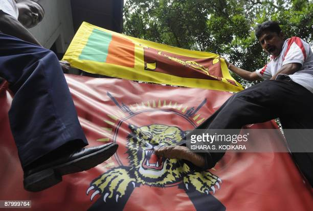Sri Lankan protestors outside the Canadian High Commission kick the flag of the Liberation Tigers of Tamil Eelam in Colombo on May 27 2009 The...