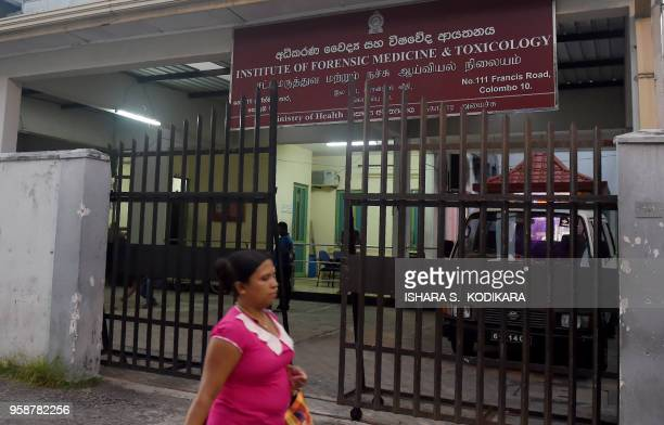 A Sri Lankan resident walks past the Institute of Forensic Medicine and Toxicology in Colombo on May 15 2018 A second visiting English amateur rugby...