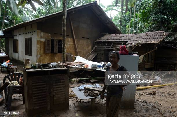 A Sri Lankan residents affected by flooding stands near her home in Molkawa in the district of Kalutara on May 30 2017 Sri Lanka appealed May 30 for...