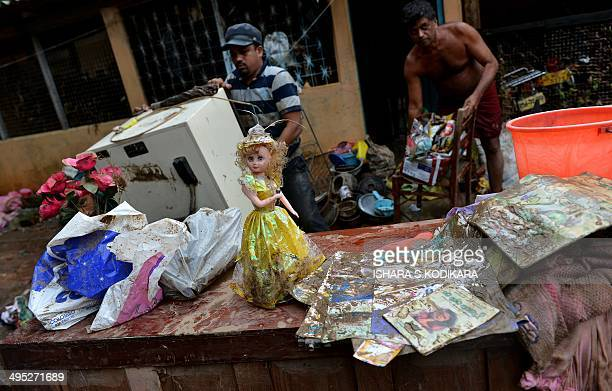 Sri Lankan residents salvage belongings following flooding in Matugamaon on June 2 2014 Mudslides cause by heavy monsoon rains in the west and south...