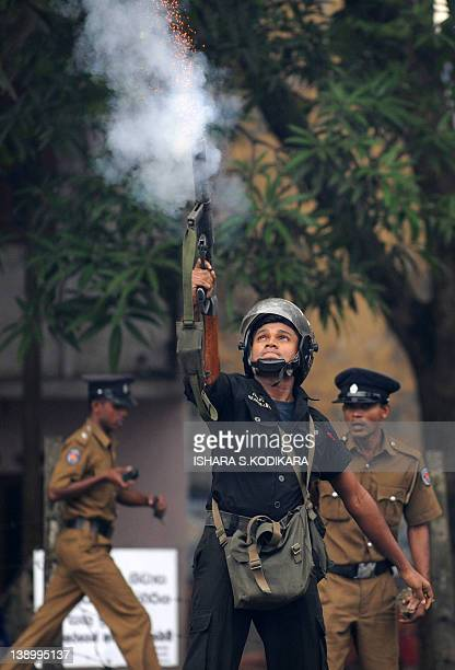 Sri Lankan riot policeman fires a tear gas canister towards protesters in Colombo on February 15, 2012. Sri Lanka's Marxist JVP party took to the...