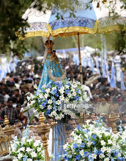 Sri Lankan Roman Catholic pilgrims pray as a statue of Our Lady of the Rosary is paraded in the northwestern village of Madhu on August 15 2009...
