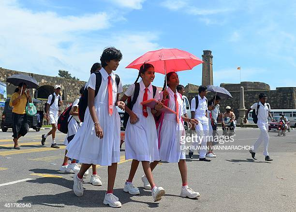 Sri Lankan schoolgirls walk past a 14th century Dutch fort after Sri Lanka transfered 41 wouldbe asylum seekers whose boat was turned away by...