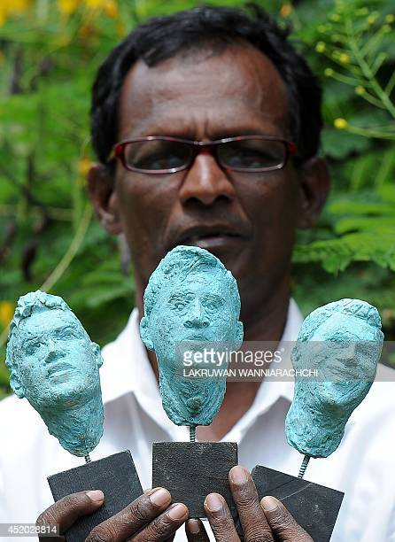 Sri Lankan sculptor Upali Dias displays four busts portraying Brazilian player Neymar Argentina player Lionel Messi and Portugal player Cristiano...