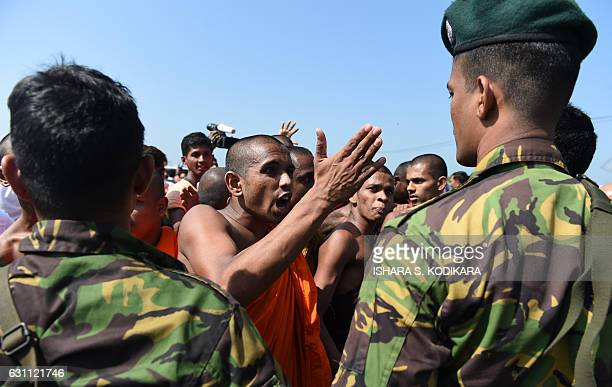 Sri Lankan security personnel and Buddhist monks clash during a protest in the southern port city of Hambantota on January 7 2017 Sri Lankan...