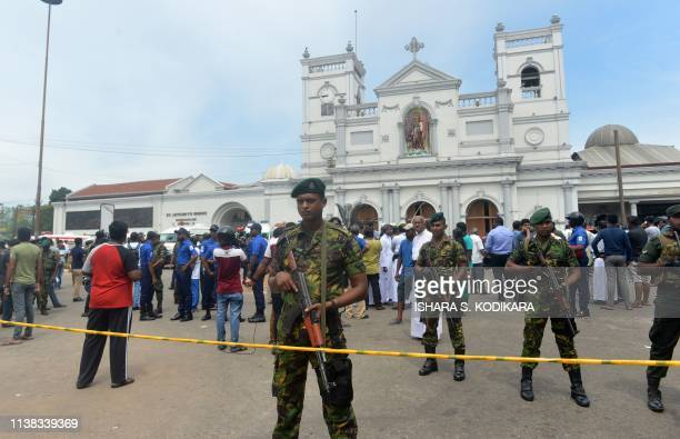 Sri Lankan security personnel keep watch outside the church premises following a blast at the St Anthony's Shrine in Kochchikade Colombo on April 21...