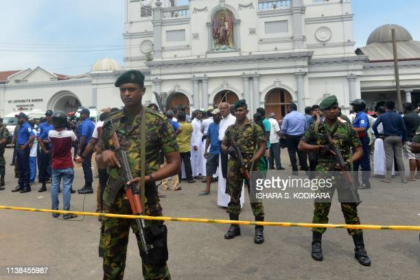 TOPSHOT Sri Lankan security personnel keep watch outside the church premises following a blast at the St Anthony's Shrine in Kochchikade in Colombo...