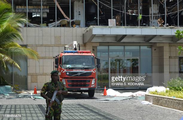 Sri Lankan security personnel stand guard at entrance to the luxury ShangriLa Hotel in Colombo on April 21 2019 following an explosion At least 42...