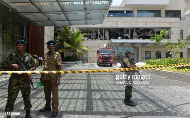 Sri Lankan security personnel stand guard at the cordoned off entrance to the luxury ShangriLa Hotel in Colombo on April 21 2019 following an...