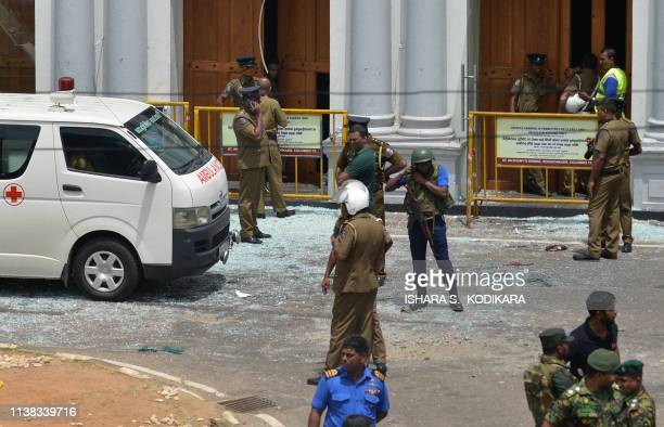 Sri Lankan security personnel stand next to an ambulance outside St Anthony's Shrine in Kochchikade in Colombo on April 21 2019 following a blast at...