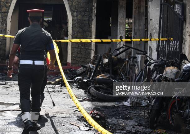 Sri Lankan security personnel walk past debris outside Zion Church following an explosion in Batticaloa in eastern Sri Lanka on April 21 2019 A...