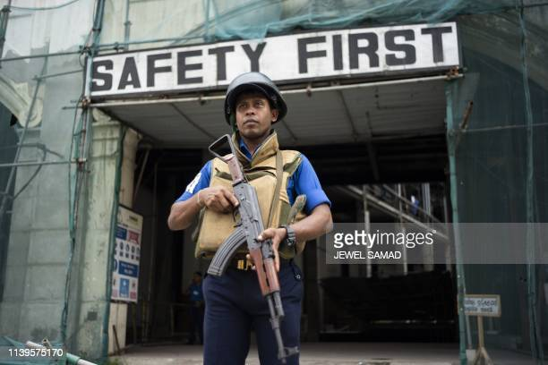 Sri Lankan soldier stands guard on a street in Colombo on April 27 following a series of bomb blasts targeting churches and luxury hotels on Easter...