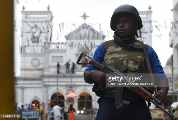 A Sri Lankan soldier stands guard outside St Anthony's Shrine in Colombo on May 2 after a series of bomb blasts targeting churches and luxury hotels...