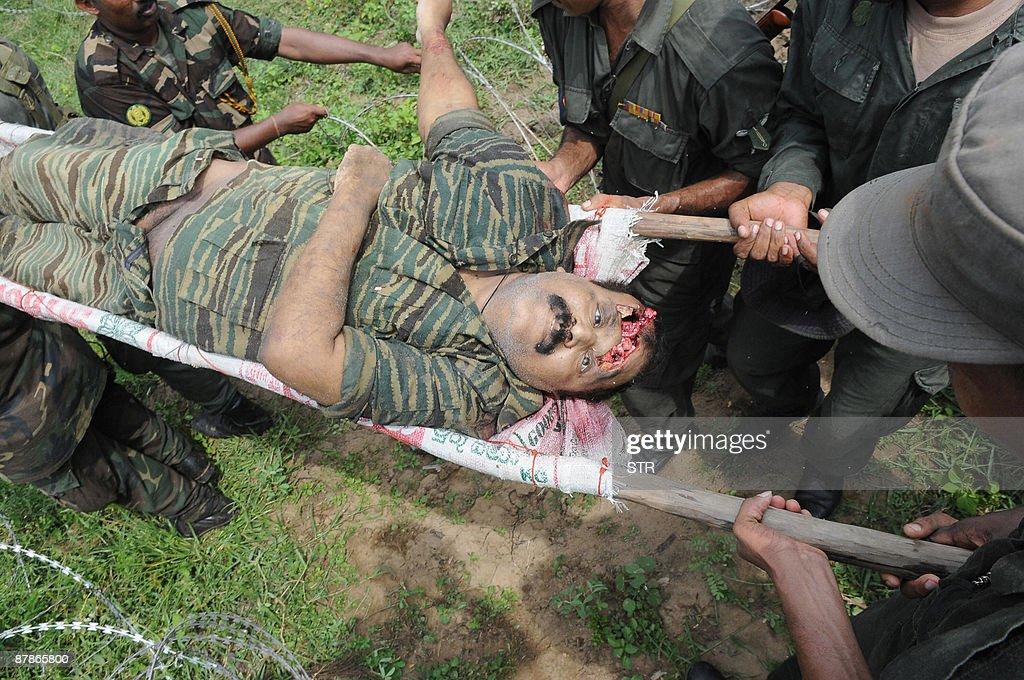 SRI LANKA OUT  Sri Lankan soldiers carry : News Photo