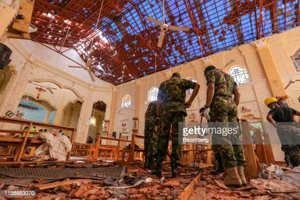 Sri Lankan soldiers inspect the damage inside St. Sebastian's Church where a bomb blast took place in Negombo, Sri Lanka, on Monday, April 22, 2019....