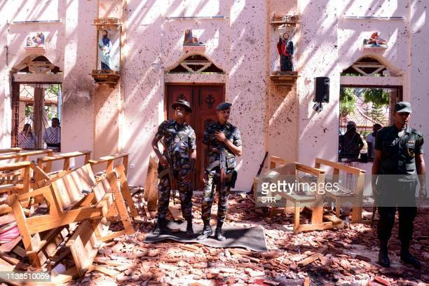 TOPSHOT Sri Lankan soldiers look on inside the St Sebastian's Church at Katuwapitiya in Negombo on April 21 following a bomb blast during the Easter...