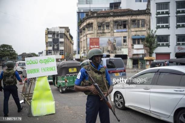 Sri Lankan soldiers man their positions at a checkpoint in Colombo on April 27 following a series of bomb blasts targeting churches and luxury hotels...