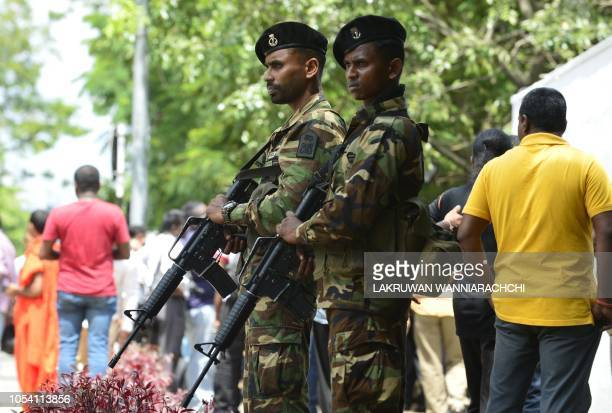 Sri Lankan soldiers stand guard at Mahinda Rajapakse's residence after he was sworn in as prime minister in Colombo on October 27 2018 Sri Lanka...