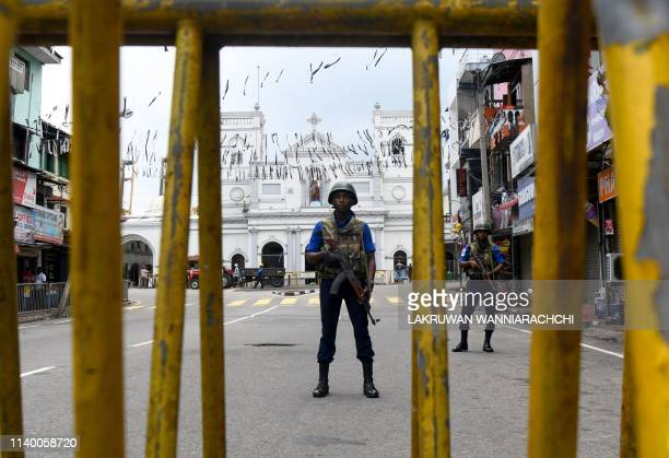 Sri Lankan soldiers stand guard outside St. Anthony's Shrine in Colombo on April 29 a week after a series of bomb blasts targeting churches and...