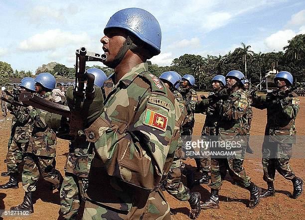 Sri Lankan soldiers wear the United Nations's blue helmets as they take part in a parade before leaving to Haiti on Sri Lanka's first UN peacekeeping...