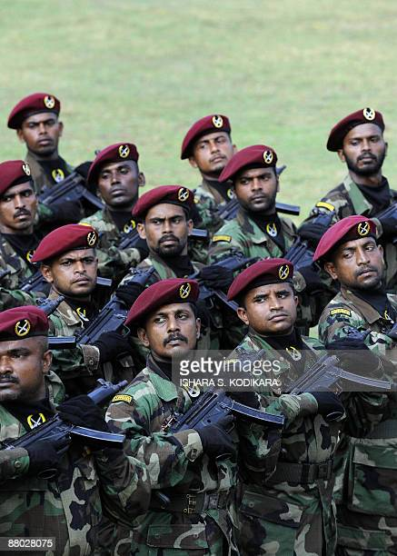 Sri Lankan special force commandos take partduring a military ceremony to felicitate the ten battlefield commanders who led the final push to crush...