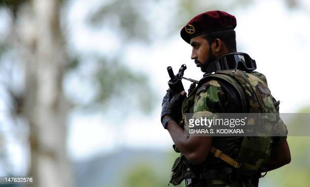 A Sri Lankan special forces commando stands guard during a ceremony for the graduation of 140 new army officers where Secretary to Sri Lankan...