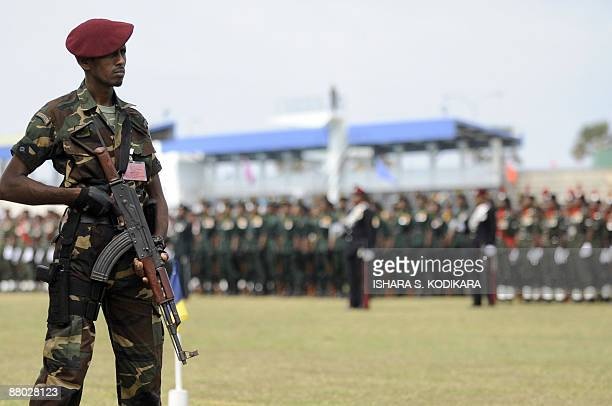 A Sri Lankan special forces commando stands guard during a military ceremony honouring 10 battlefield commanders who led the final push against the...