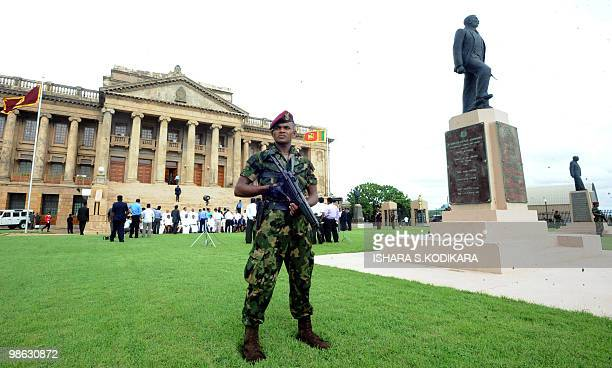 A Sri Lankan special forces commando stands guard outside the parliament in Colombo on April 23 2010 Sri Lanka's new Cabinet was sworn in by Sri...