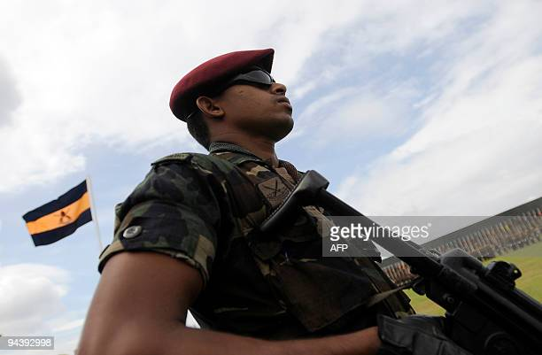 Sri Lankan special forces take part in a ceremony commemorating the victory over Tamil Tiger rebels at army headquarters in Colombo on December 14...