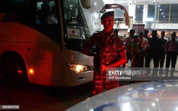 A Sri Lankan Special Task Force soldier stands guard as the Sri Lankan cricket team bus leaves the ground at the end of the first One Day...
