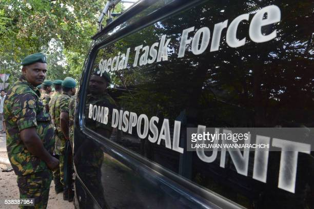 Sri Lankan Special Task Force soldiers gather in the streets of Salawa on the edge of the capital Colombo on June 6 hours after an explosion at an...