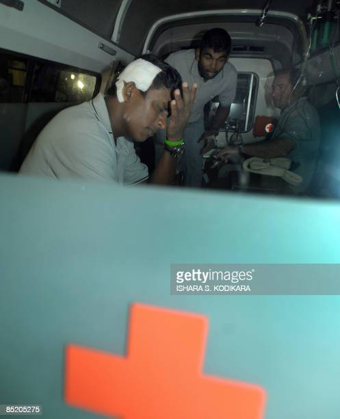 Sri Lankan spinner Ajantha Mendis and Tharanga Paranavithana and assistant coach Paul Farbrace are taken aboard an ambulance on March 4 2009 shortly...