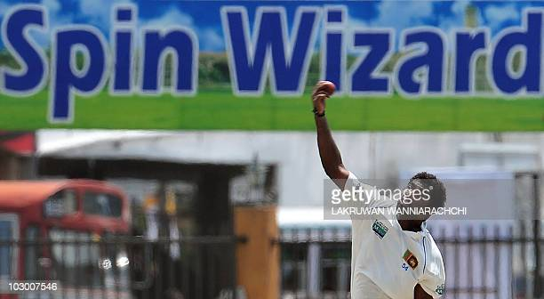 Sri Lankan spinner Muttiah Muralitharan delivers a ball during the fourth day of the first Test match between Sri Lanka and India at The Galle...