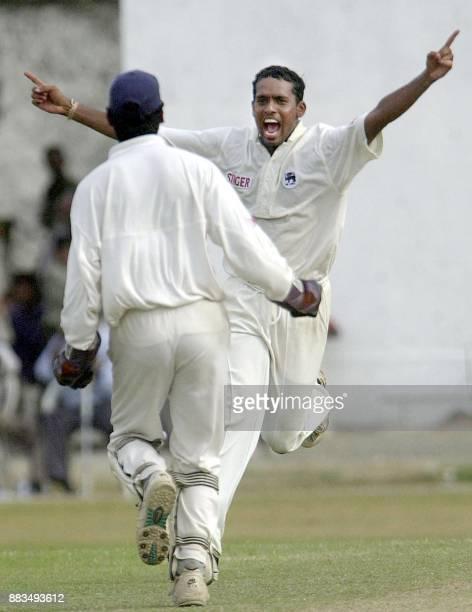 Sri Lankan spinner Tilan Sameeraweera and wicketkeeper Kumara Sangakkara celebrate after Sameeraweera dismissed Indian skipper Sourav Ganguly on the...